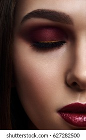 Woman with Smoky Eyes Make-Up and dark red Lips