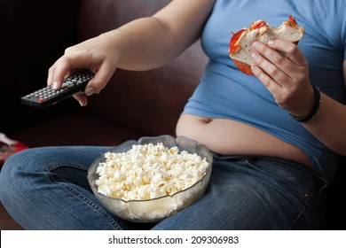 Woman snacking and zapping.