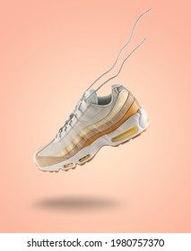 Woman Sneaker on peach color background, woman fashion, sport shoe concept, floating idea, Nike air max 95, product photography, trending shoes, adidas, puma, veya, new balance, Asics