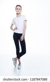 woman sneakers leggings T shirt light background
