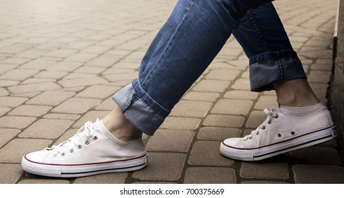 Woman in sneakers on the street, Soft focus