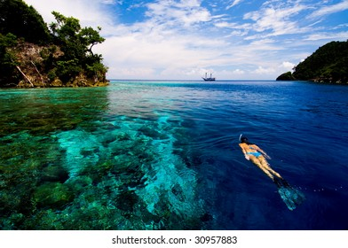 Woman snorkeling in coral reef