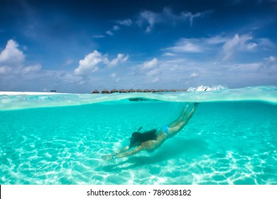 Woman snorkeling under tropical water in the Maldives