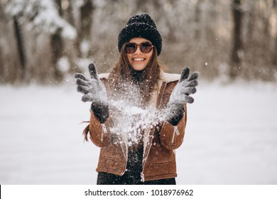 Woman with snow in hands outside
