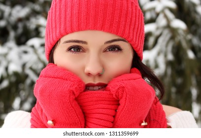 Woman in the snow, woman wearing mittens, woman wearing scarf, woman wearing winter hat, matching mittens and scarf, pink hat and mittens, coral mittens and hat, snow portrait, winter portrait