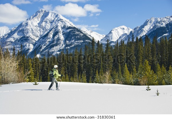 Woman snowshoeing in Banff National Park, Canada