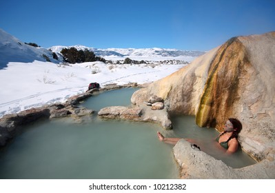 A woman soaks in natural hot springs in California.