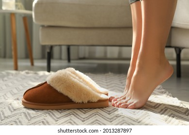 Woman with soft slippers at home, closeup