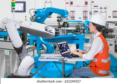 Woman software engineers developing automated robotic in production line, Industry 4.0 concept