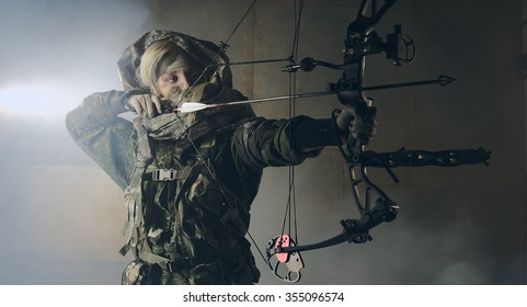 Woman soldier with a bow. Fantasy. The post Apocalypse.