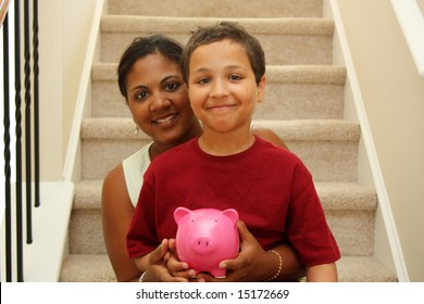 Woman and Son Holding Piggy Bank With Savings