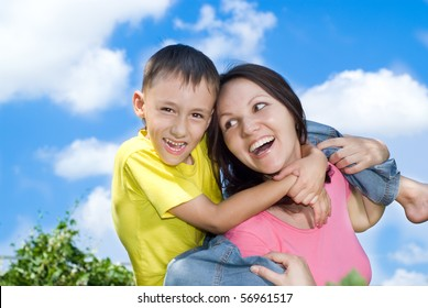 woman  with  son on a background of sky