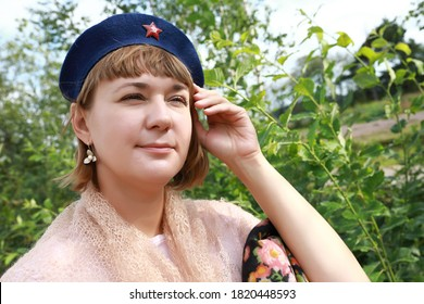 Woman in Soviet military beret in tpark