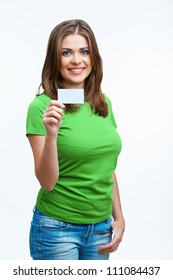Woman sowing blank card. Isolated on white background smiling female portrait. Green color dressed.