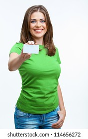 Woman sowing blank card. Isolated on white background smiling female portrait . Green color dressed.
