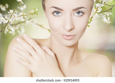 woman spa  beauty portrait over floral green background