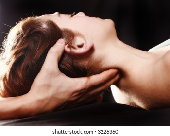 woman in a spa with a black background