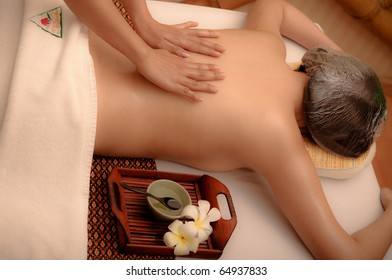 Woman in spa getting a deep tissue massage.