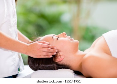 Woman in a spa getting a massage and relaxing