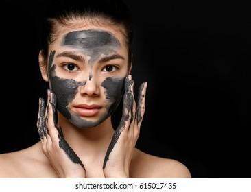 Woman spa mask black half-face beauty concept.