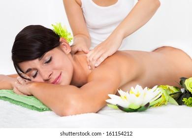 Woman In Spa Salon Lying On Towel