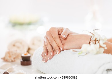 Woman in spa with well manicured nails.