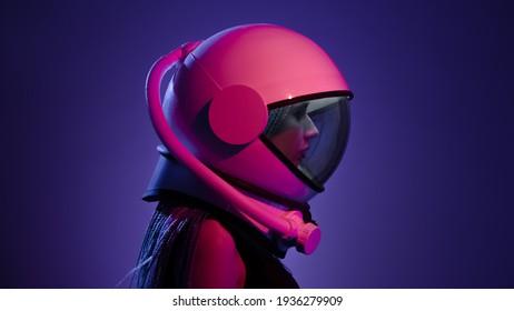 Woman in a space helmet. Multi-colored neon lighting.