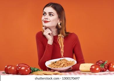 woman with spaghetti on orange background