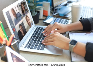 Woman speak talk on video call with colleagues on online briefing during self isolation and quarantine. Webcam group conference with coworkers on laptop at home. Work online and stay at home
