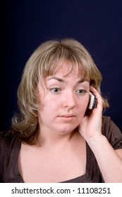 The woman speaking by phone close up