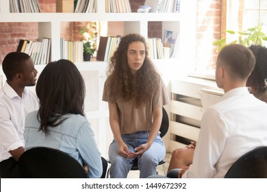 Woman speaking at group counselling therapy session sitting in circle, psychological treatment, addiction, girl sharing problem with diverse friends, young psychologist working with patients