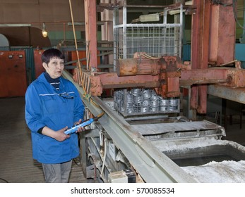 Woman  specialist  handles   metal   electroplating   shops