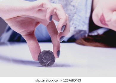 Woman spinning a coin to make decision. Heads or tails game. (chance, opportunity, fortune, luck concept)