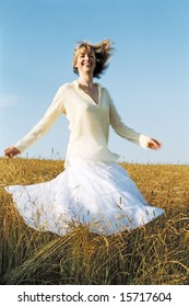 Woman spinning outdoors smiling