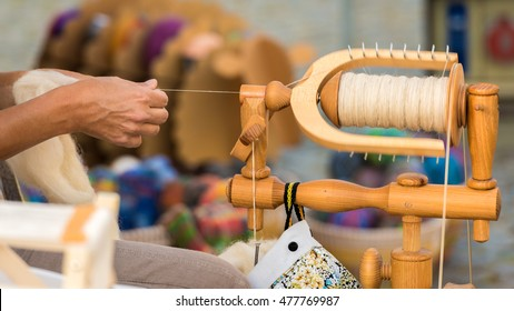A woman at the spinning wheel