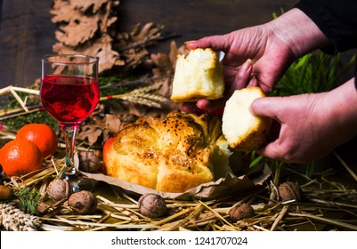 Woman splitting Orthodox Christmas eve bread closeup