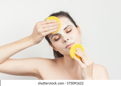 woman with a sponge blue background cotton pad problem skin.