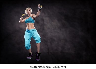 woman in sport dress at boxing exercise on the night street