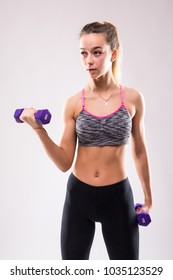 Woman in sport equipment practice with hand weights