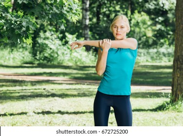 Woman sport exercise stretching fitness training summer nature time.