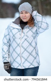 Woman in sport winter jacket standing outdoor at cold wintry weather