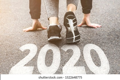 Woman in sports uniform running around. Healthy way of life, an infused figure. sneakers close-up, finish 2019 Start to new year 2020, plans, goals, objectives