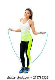 woman in sportswear holding a jumping-rope