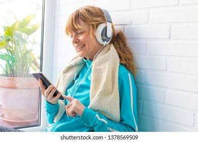 woman with sportswear mobile phone and earphones