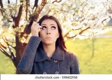 Woman with Spring Allergies Using Eye Drops - Cute girl suffering from an ophthalmological allergic reaction to pollen