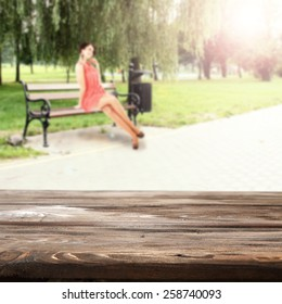 woman in spring dress on bench and worn old desk space