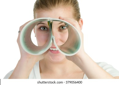 Woman spying through a double roll of paper.