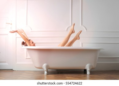 Woman sreching in the bathtub