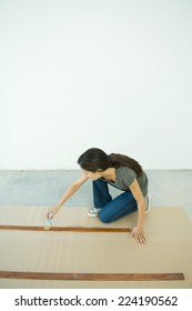 Woman staining slats of wood