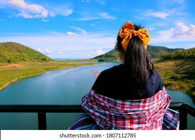 woman stand back and watch the river and beautiful nature. relaxing day. Mae Kuang Dam. It's a very good and quiet place with beautiful nature and amazing landscapes. Chiang Mai, Thailand.